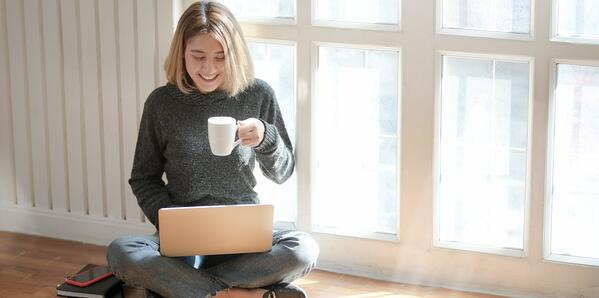 woman-sitting-on-floor-working-laptop